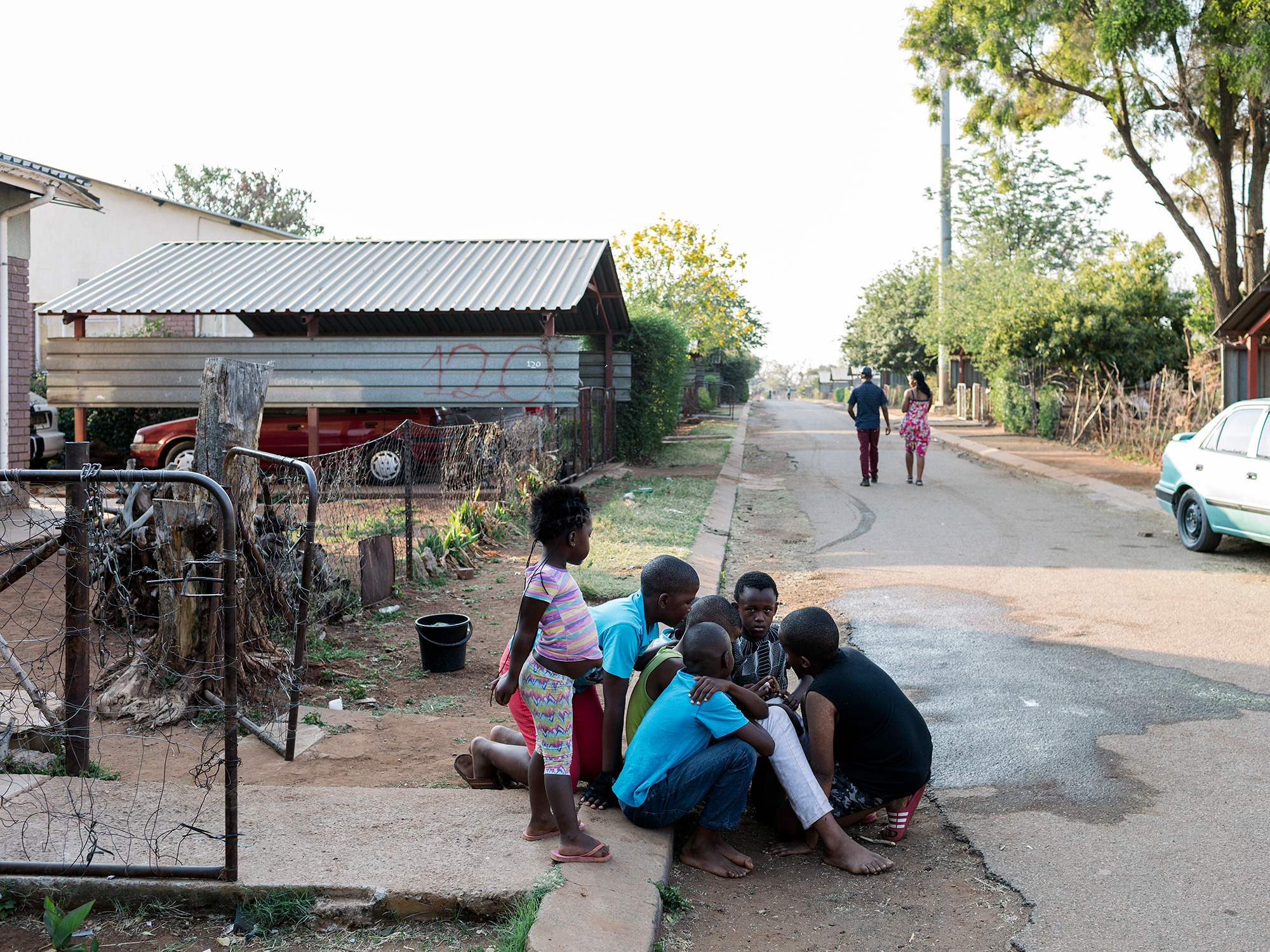 Children play in the streets, Hostel for married mineworkers, Wonderkop, Marikana, North West, Western Limb