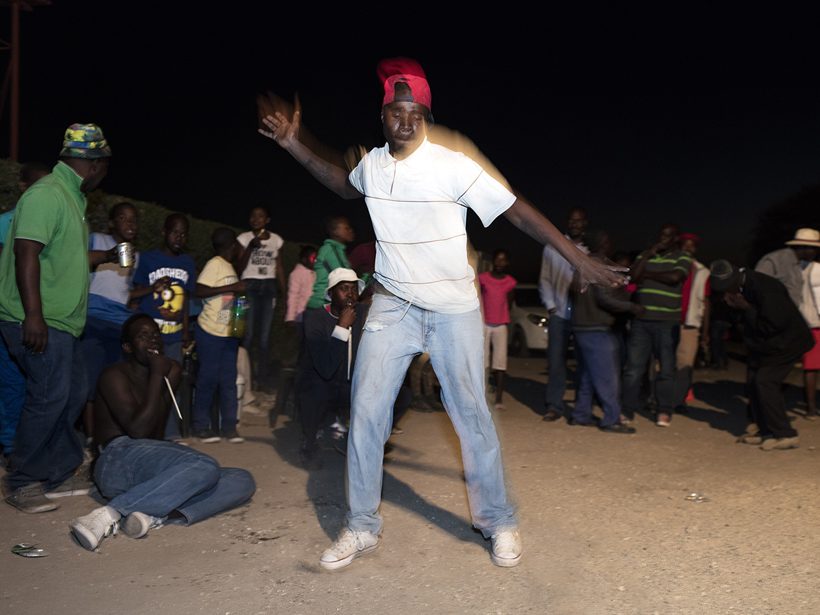 Community members gather at a wedding celebration to watch Dinaka Traditional Dance's entertain the bride and groom, Ga-Chaba Village, Mapela, Limpopo, Northern Limb